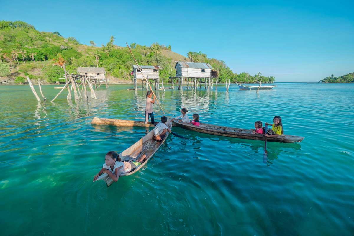 Skillful sea Gypsy kids in wooden boat canoe called lepa-lepa